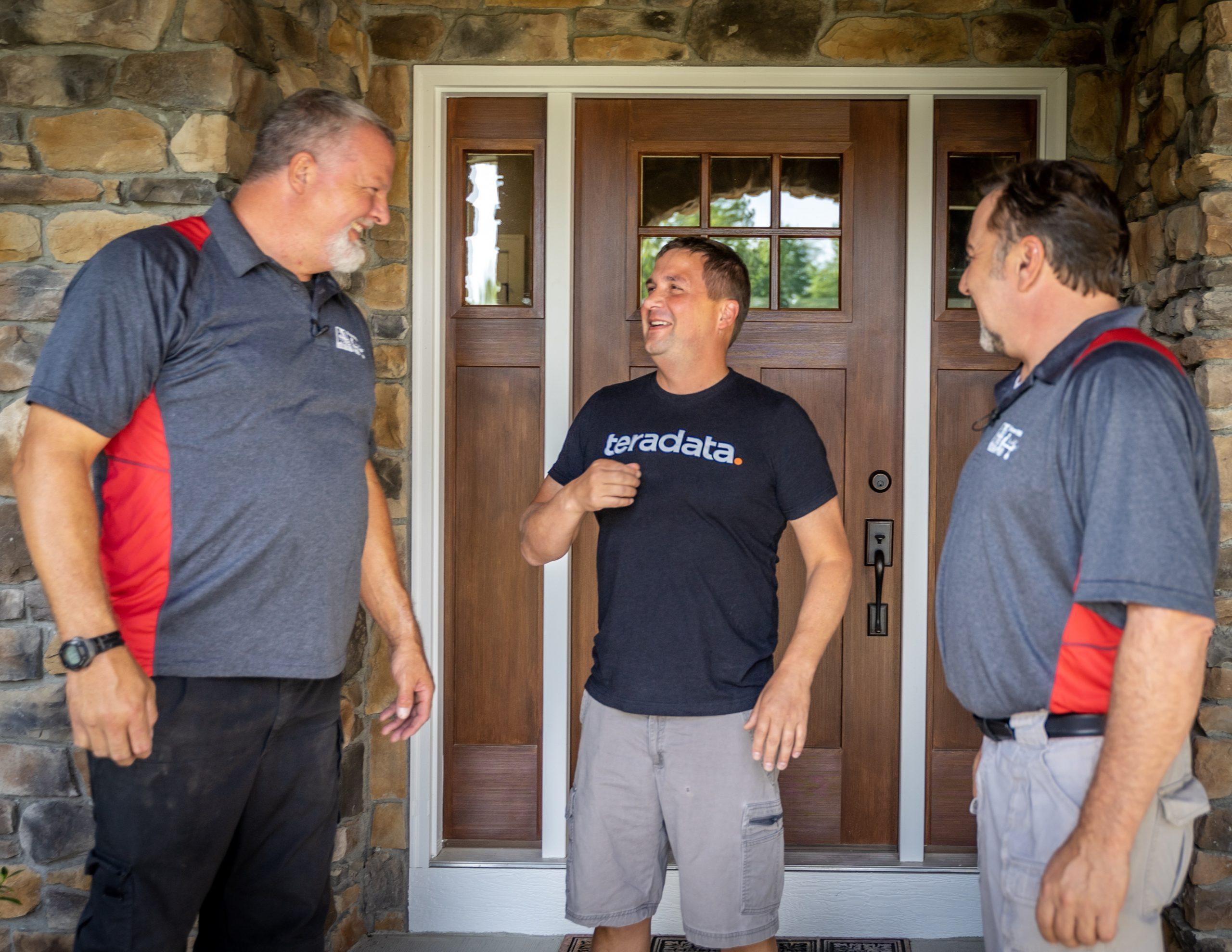 service technicians discuss pest control and elimination